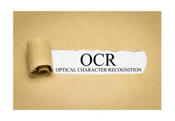 Ein aufgerissener Bogen legt das Wort OCR frei